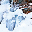 Stock Photo: Huge icicles on a mountain
