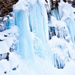 Huge icicles on a mountain — 图库照片