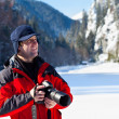 Professional photographer in the winter landscape — Stock Photo