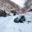 Car stuck in a snow avalanche - Stock Photo