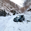 Stock Photo: Car stuck in snow avalanche