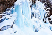 Huge icicles on a mountain — Stock Photo