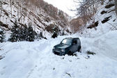 Car stuck in a snow avalanche — Stock Photo