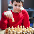 Boy playing chess, selective focus — Stock Photo