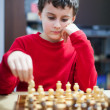 Boy playing chess, selective focus - Stock Photo