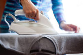 Woman's hands ironing — Stock Photo
