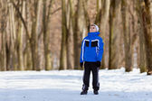Boy near forest, in a winter day — Stock Photo