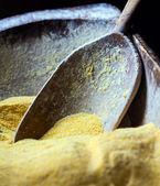Wooden spoon in corn flour — Stock Photo