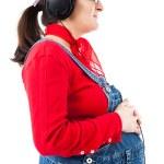 těhotná žena se sluchátky — Stock fotografie #9697955