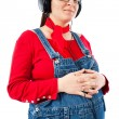 Pregnant woman with headphones - Stock Photo