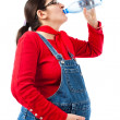 Pregnant woman with bottle of water — Stok fotoğraf