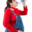 Pregnant woman with bottle of water — Stock fotografie