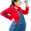 Pregnant woman with bottle of water - Stok fotoraf