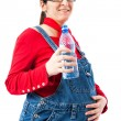Pregnant woman with bottle of water - Stock Photo