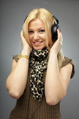 Beautiful blonde with headphones — Stock Photo