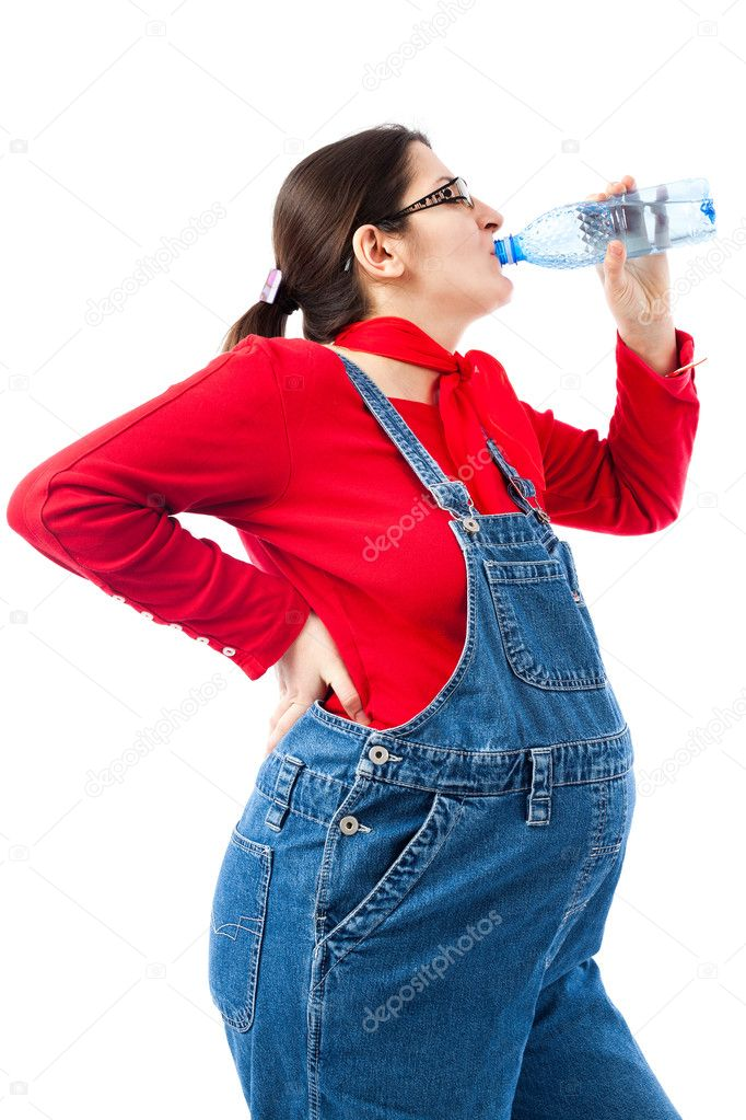 Preganant woman with a bottle of water isolated on white background — 图库照片 #9698022