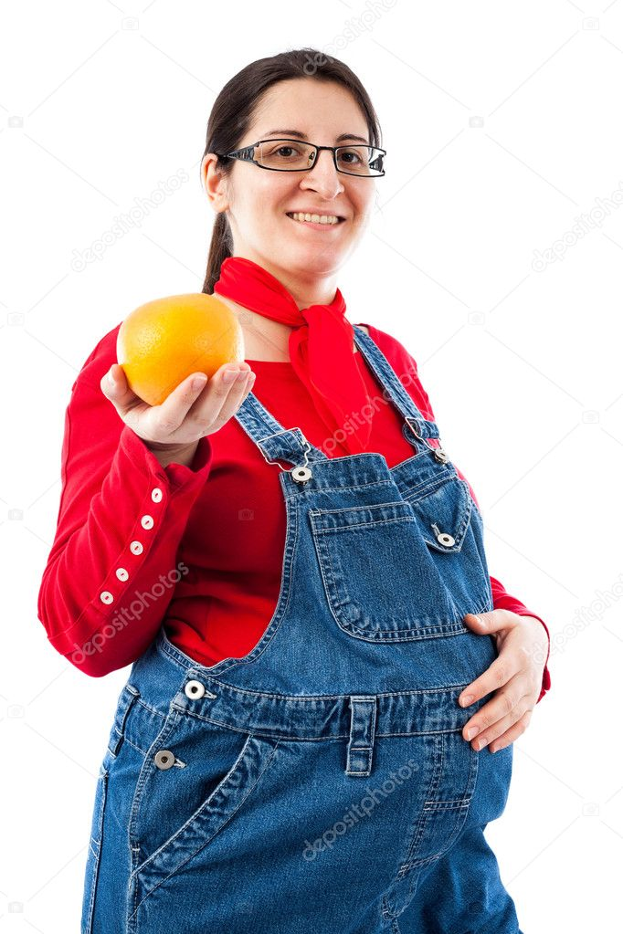 Pregnant woman with orange fruit isolated on white background — Стоковая фотография #9698050