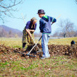 Family at work in an orchard — Stock Photo #9820327