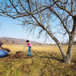 Mother and daughter working in an orchard — Stock Photo #9823664