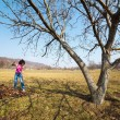 Young woman with a rake in an orchard — Stock Photo #9823677