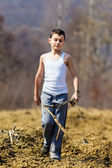 Boy walking on plow soil — Stock Photo