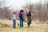 Family returning from work in the field — Stock Photo