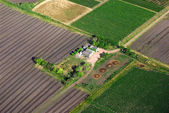 Aerial view of a landhouse with green fields — Stock Photo