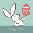 Easter bunny with painted egg - Stock Vector