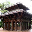 Stock Photo: Buddist temple set in gardens