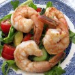 Prawns salad with lettuce, tomato, avocado and cucumber - Stock Photo