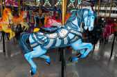 Blue carousel horse — Stock Photo