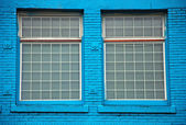 Windows in blue wall — Stock Photo