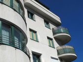 Building with balconies on a background blue sky — Stock Photo