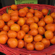 Basket of citrus on street market with clipping path — Foto Stock