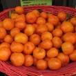 Basket of citrus on street market with clipping path — 图库照片