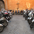 Stock Photo: Row of motorcycles on old street in Roma