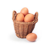 Eggs in the basket on a white — Stock Photo
