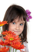 Little girl with bouquet — Stock Photo
