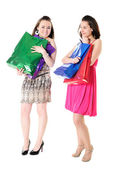 Funny girls with shopping bags — Stock Photo
