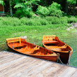 Boats on a forest lake — Stock Photo