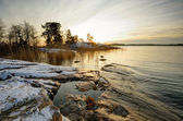 Zonsondergang in de winter in finland — Stockfoto