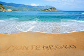 """Montenegro"" writing on the sand — Stock Photo"