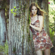 Fashion portrait of young sensual woman in garden — Stock Photo