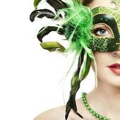The beautiful young woman in a green venetian mask — Stock Photo