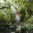 Portrait of romantic woman in fairy forest — Stok fotoğraf