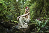 Portrait of romantic woman in fairy forest — Stock Photo