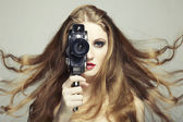 Portrait of a beautiful woman with the camera — Stock Photo