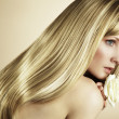 Fashion photo of a young woman with blond hair — Stock Photo