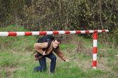 A young man passes under the barrier — Stock Photo