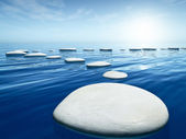 Step stones in the blue sea — Stock Photo